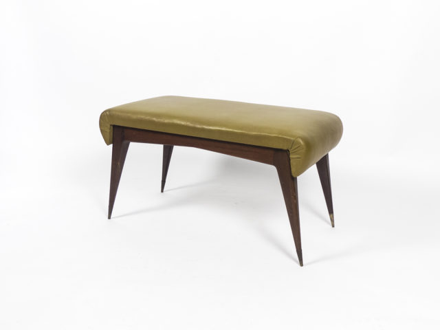 Sculptural ottoman with brass tips